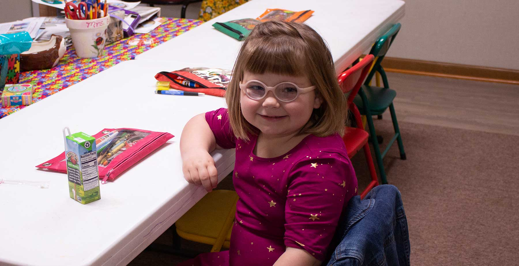 Little girl with glasses in Sunday School