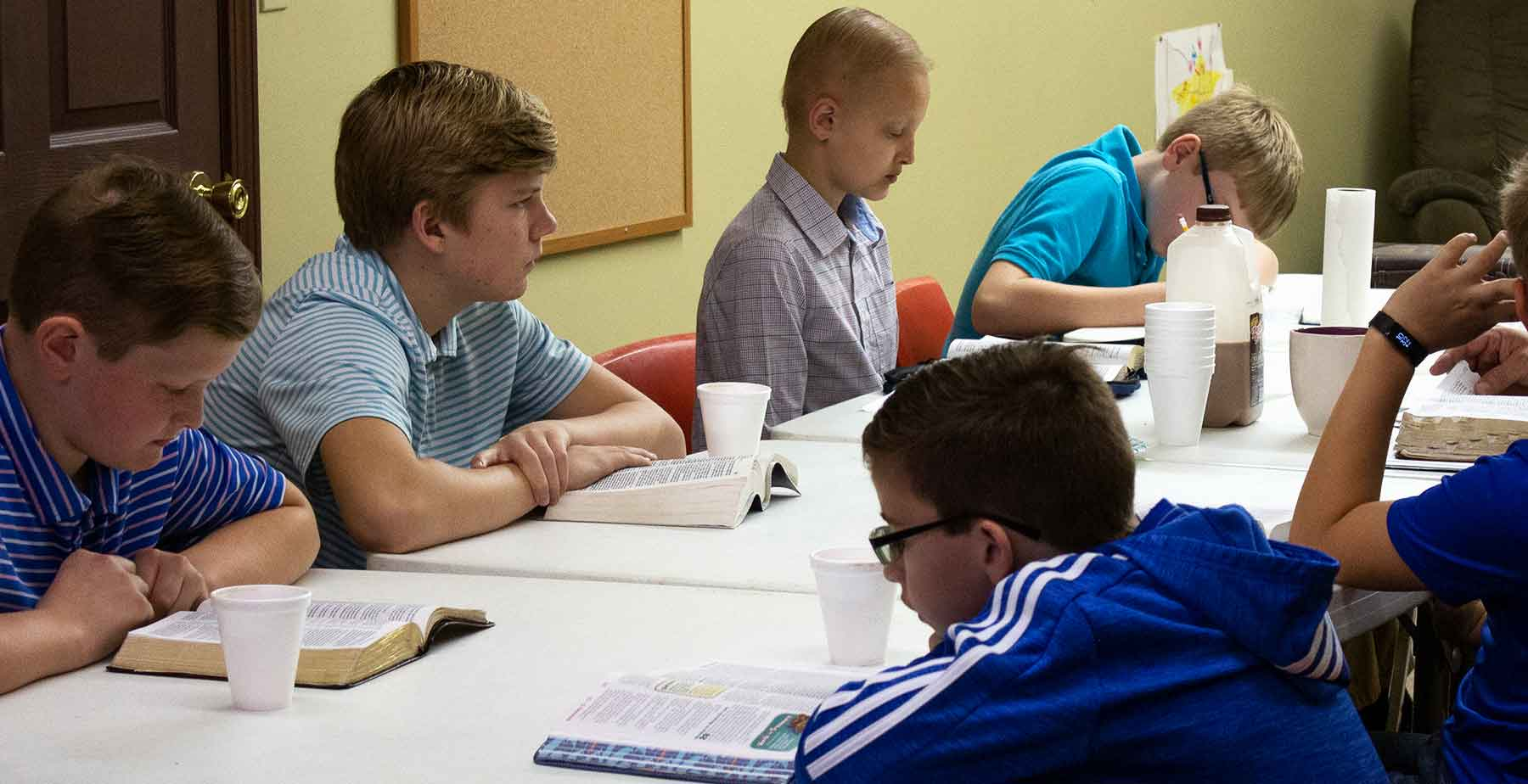 A photo of preteen Boys in a bible study